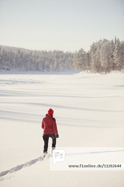 Woman walking through snow