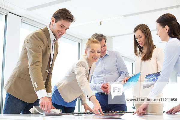 Business people having discussion at table in new office