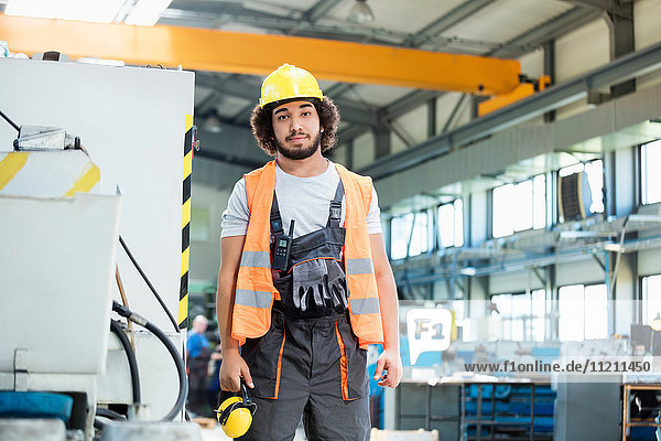 Portrait of confident manual worker wearing protective clothing in metal industry