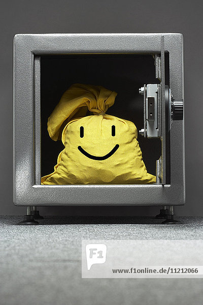 Safe with yellow sack with happy face on it