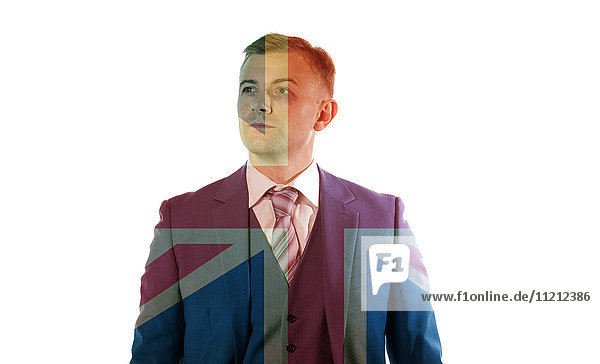 Portrait of an business man with black eye standing over Union Jack