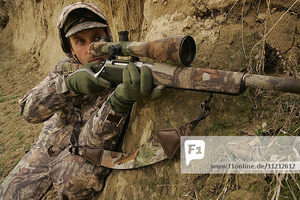 Varmint Hunter With Rifle