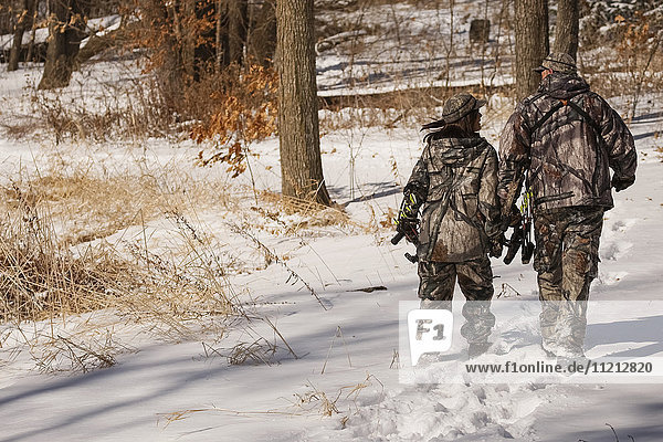 Male And Female Bowhunters