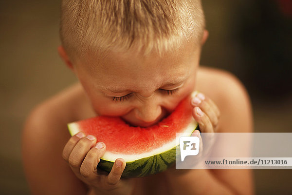 Boy Eating A Slice Of Watermelon
