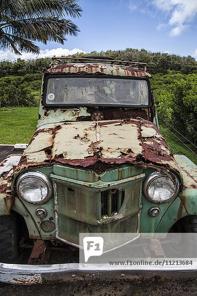 'Rusted and weathered vintage car; Molokai  Hawaii  United States of America'