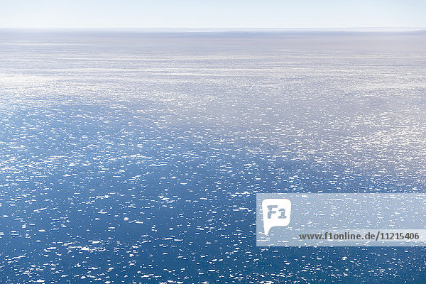 'Aerial view of the Arctic Ocean on a clear day  icebergs floating in the sea  North Slope; Deadhorse  Alaska  United States of America'