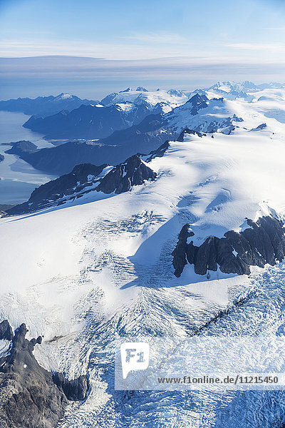 'Aerial view of the Harding ice field and glaciers decending from its snowy peaks  Prince William Sound in the background  Kenai Peninsula  Southcentral Alaska; Seward  Alaska  United States of America'