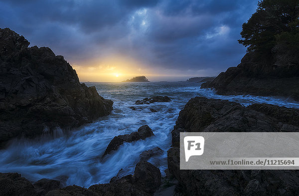 'Sunset over the ocean near the town of Tofino; British Columbia  Canada'