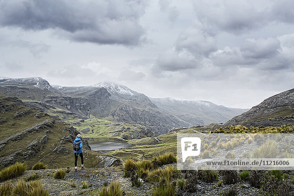 'Hiker standing on top of a mountain  just north of Tupiza; Bolivia '