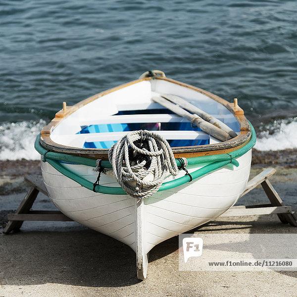 'A rowboat on the shore at the water's edge; Capri  Campania  Italy'
