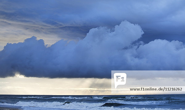 'Stormy sunset over a west coast sea; Greymouth  South Island  New Zealand'