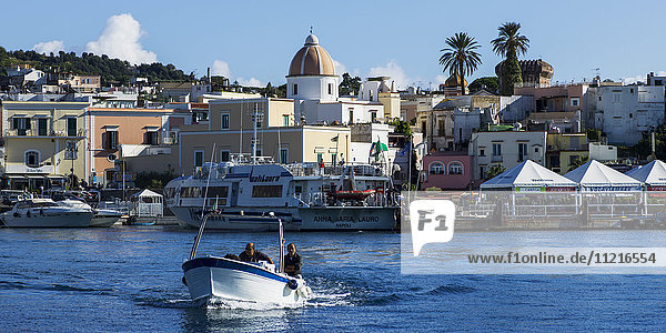 Boating in the harbour off the coast of Ischia; Ischia  Campania  Italy
