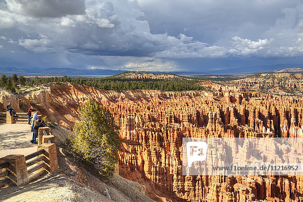 Tourists admiring the view  hoodoos viewed from Inspiration Point  Bryce Canyon National Park; Utah  United States of America