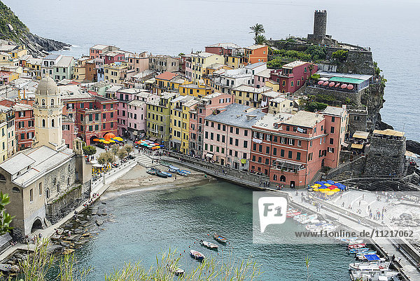 Colourful buildings and boats in the harbour  Cinque Terre; Vernazza  Italy