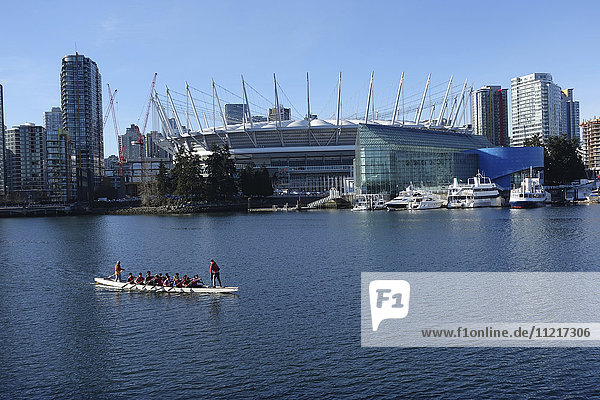 Dragon boat in front of BC Place; Vancouver  British Columbia  Canada