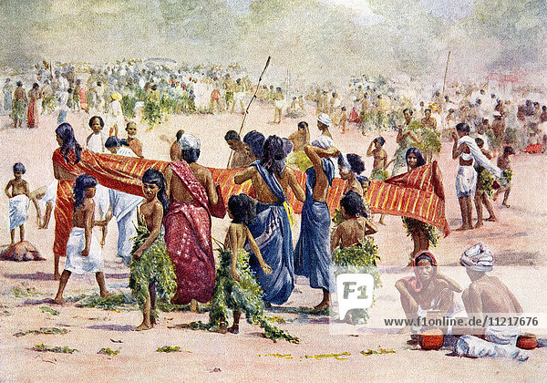 The annual festival of the village goddess of Periyapalayam  Tamil Nadu State  India. Men  women and children in the performance of a vow dressed in leafy garments made of twigs of the sacred mangosa tree. The devotees pay a small fee for admission to the temple precincts and circle the shrine three or more times. From Customs of The World  published circa 1913.