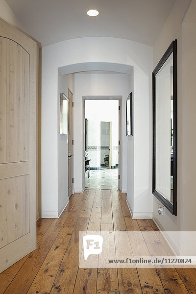 Hallway with mirror on wall in home,  California,  USA