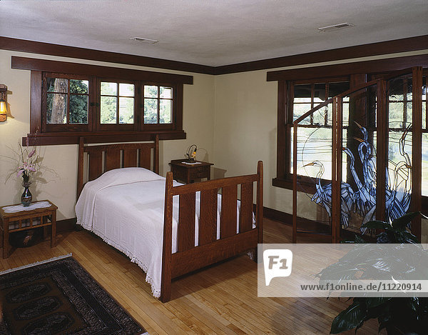Small bedroom with small bed