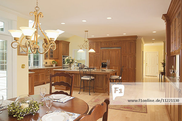 Spacious traditional kitchen with wooden cabinets and dining area