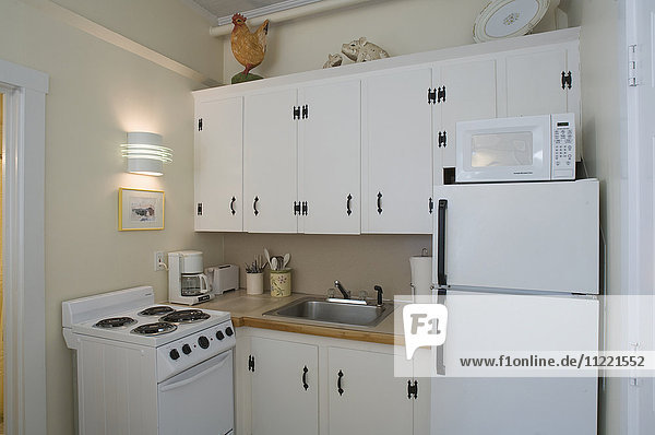 Small white apartment kitchen