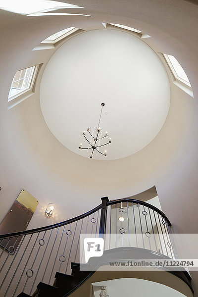Low angle view of staircase and circular ceiling