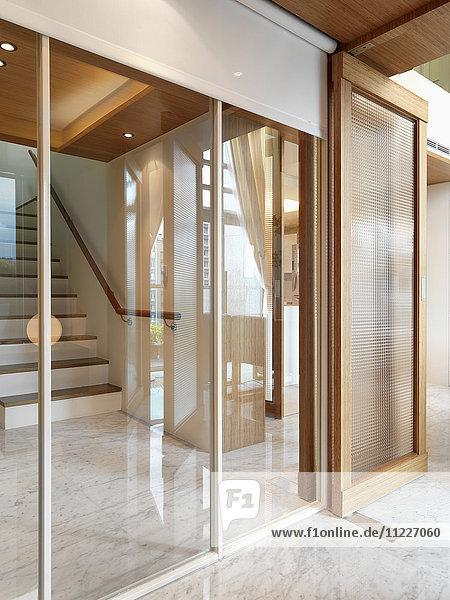 View through interior windows to modern staircase