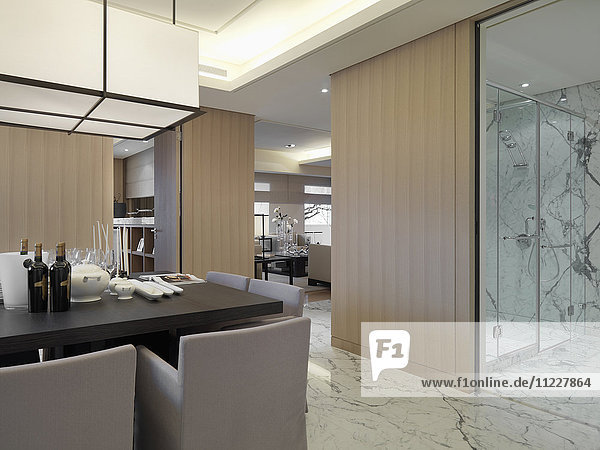 Dining table in modern interior with marble floors