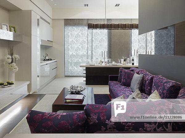 Modern purple sofa outside kitchen