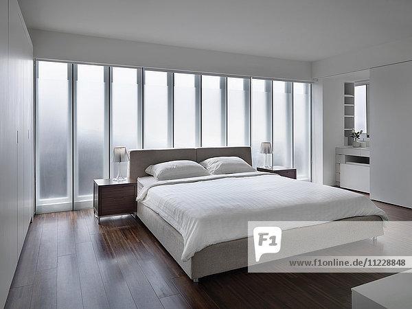 Modern white bedroom with hardwood floors