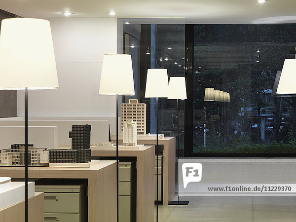 Repetitive lamps in modern office at night