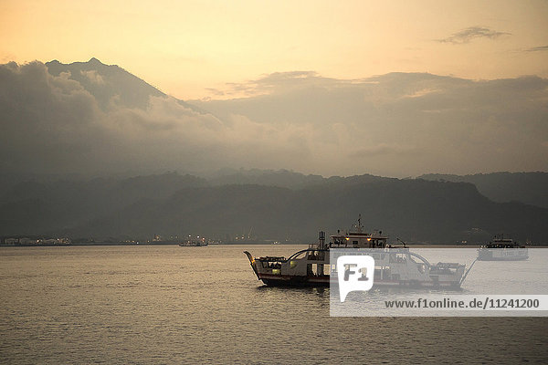 Indonesia  ferry between Bali and Java at twilight