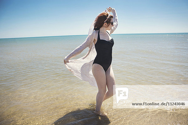 Young woman dancing in sea  Narbonne  France