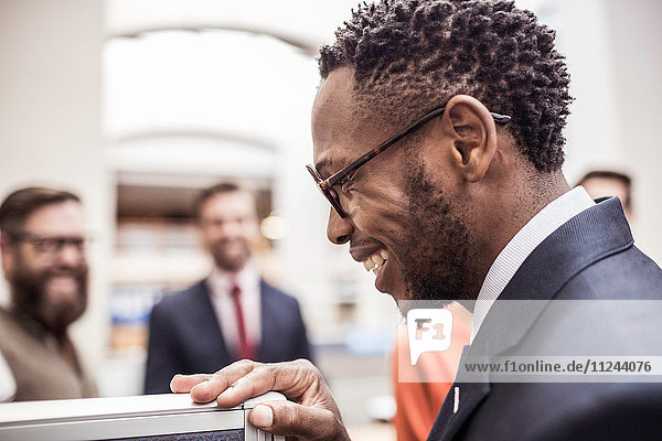 Profile of happy young businessman in office