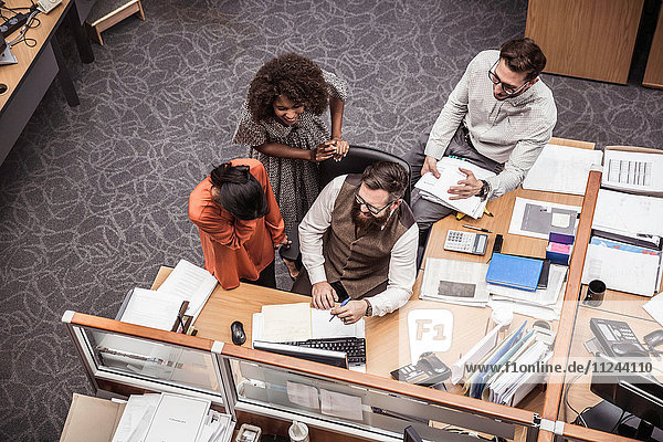 Overhead view of business team meeting at office desk