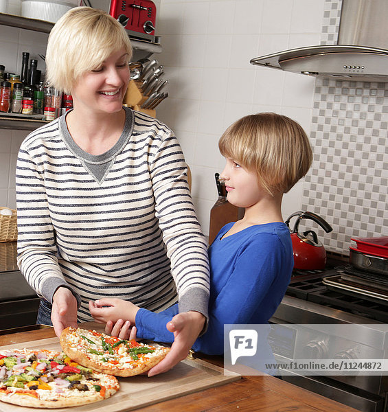 Mother and daughter in kitchen preparing food