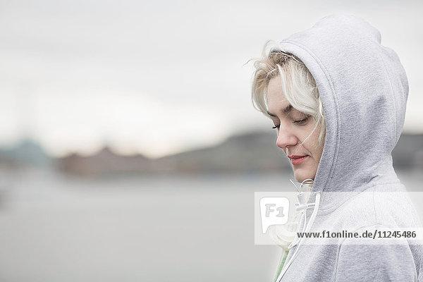 Female runner looking down on dockside