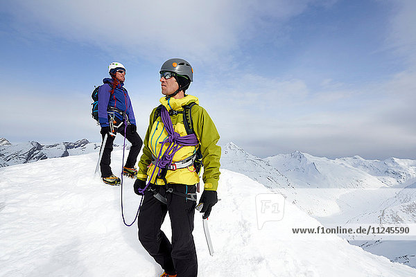 Mountaineers on top of snow-covered mountain looking away  Saas Fee  Switzerland