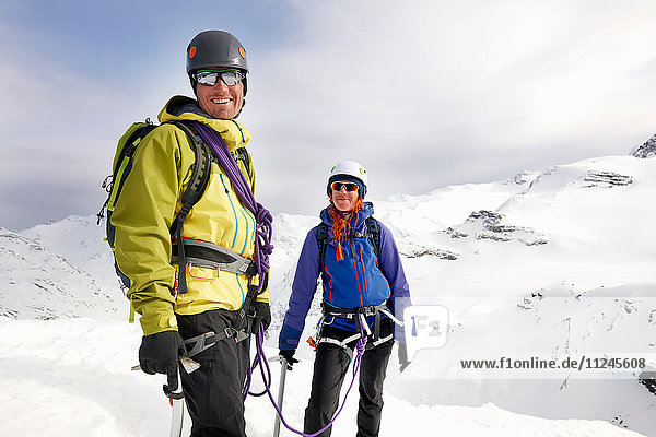 Mountaineers on snow-covered mountain looking at camera smiling  Saas Fee  Switzerland