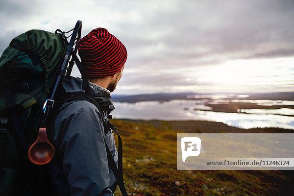 Hiker enjoying view of lake  Keimiotunturi  Lapland  Finland