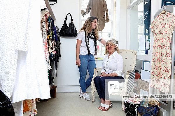 Portrait female shop owner and shop assistant in fashion boutique