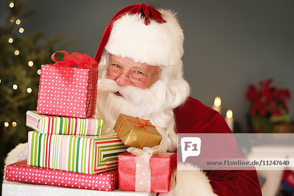 Portrait of Santa Claus holding Christmas presents