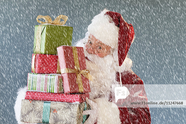 Portrait of Santa Claus carrying Christmas presents