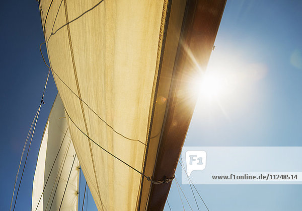 Close-up of sun shining through boat's sail Close-up of sun shining through boat's sail