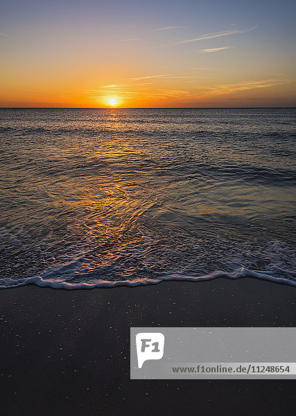 Beach and sea at sunset