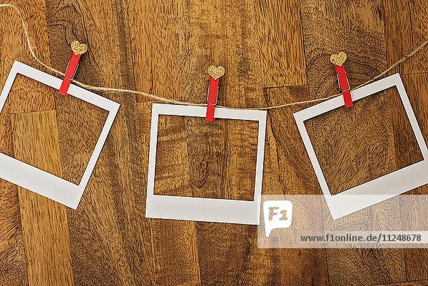 Empty Polaroid frames in a row on wood