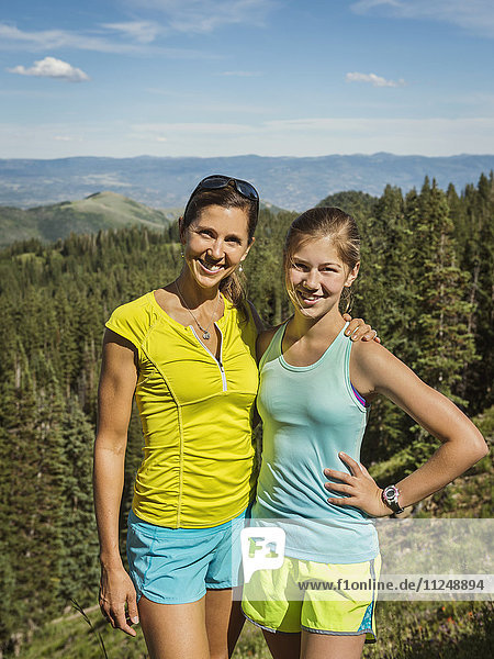 Mother and daughter (14-15) in mountains