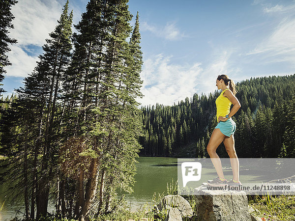 Mature woman standing on rock