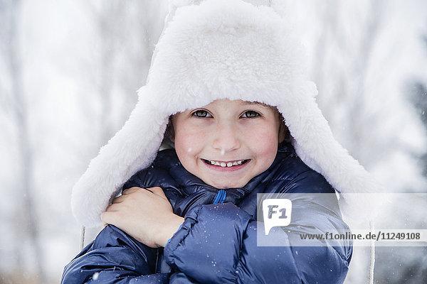 Portrait of boy (6-7) in fur hat