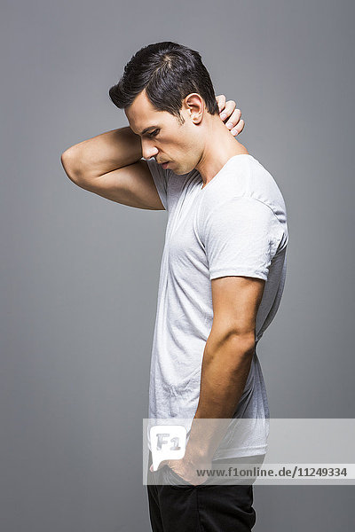 Man in white t-shirt on grey background