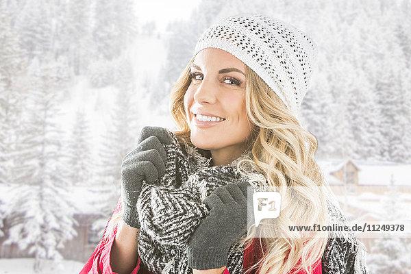 Portrait of young woman in winter wear